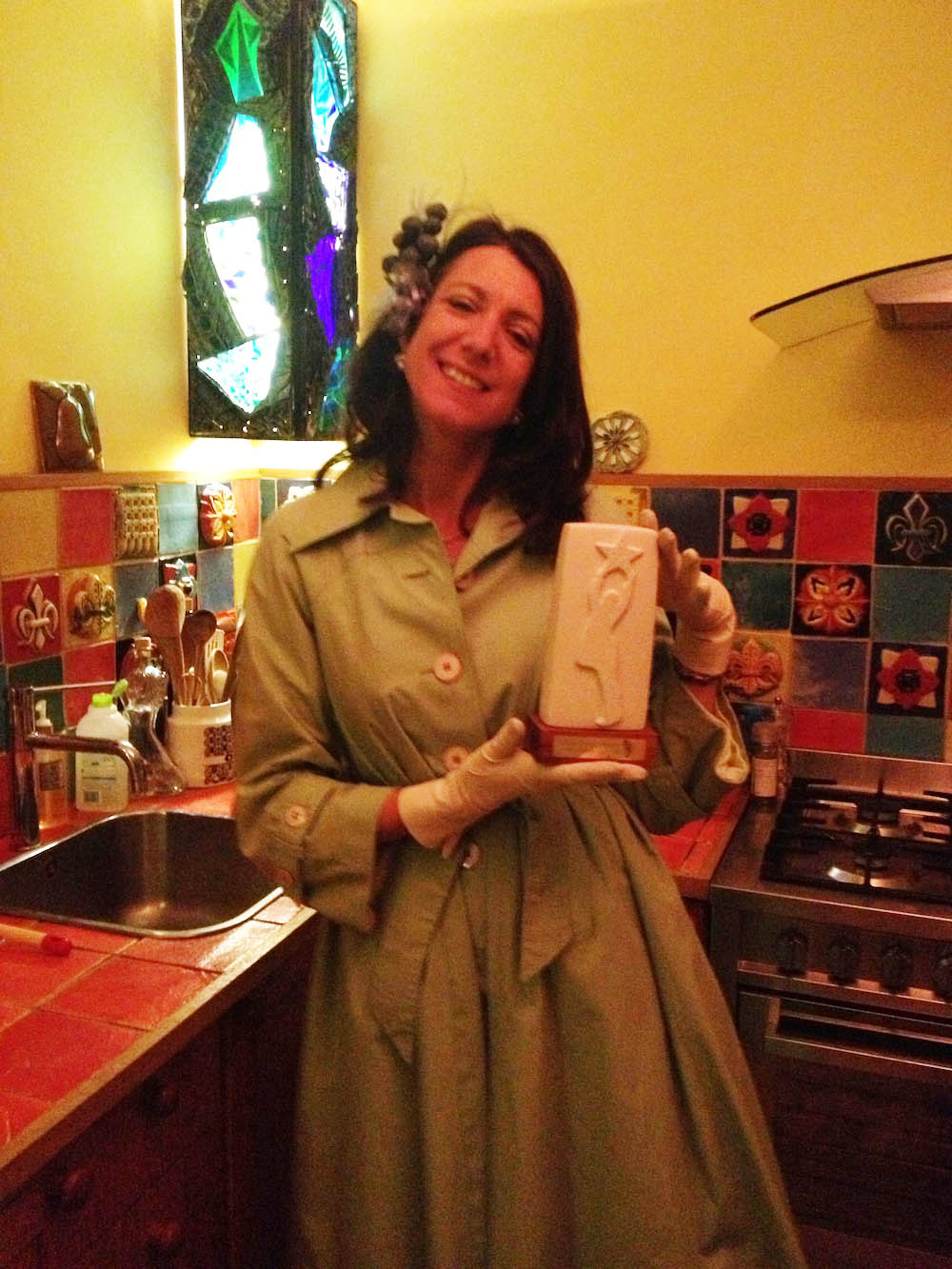 KAY WITH AWARD IN TUDOR KITCHEN